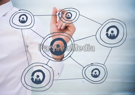 geschaeftsmann mitten im zeichnen des netzwerkes