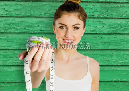 fitness woman apple and meter with