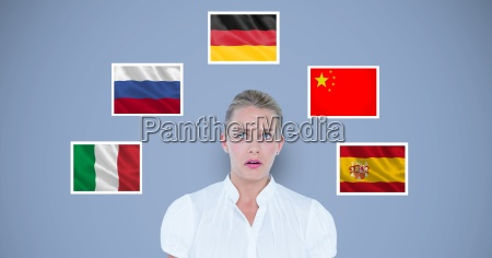 businesswoman standing by various flags against