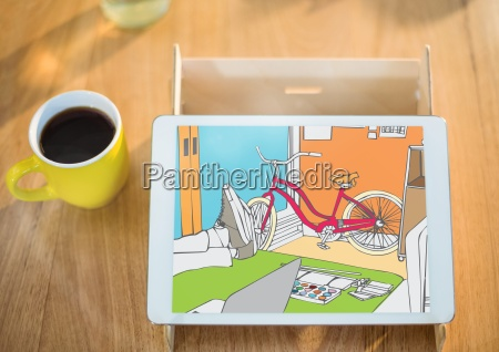 tablet on support on desk near