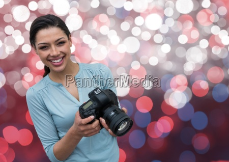 happy young photographer with camera on