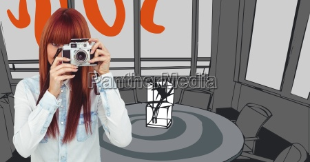 millennial woman with camera against orange