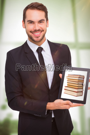 composite image of smiling businessman showing