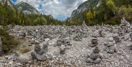 stone figures multiple in a riverbed