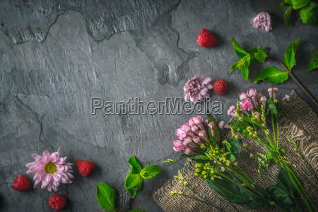 flowers raspberries and mint on