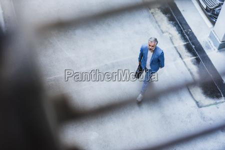 businessman walking holding bag