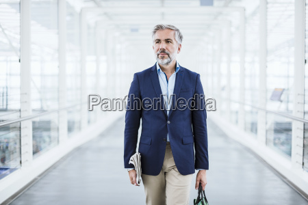 businessman walking in passageway