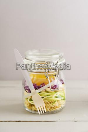 preserving jarr of vegan mixed salad
