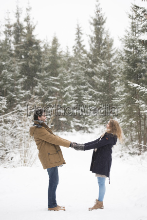 happy young couple standing hand in