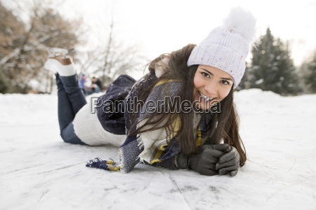 woman with ice skates lying on