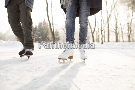 close up of two ice skaters