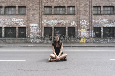 woman sitting on the street