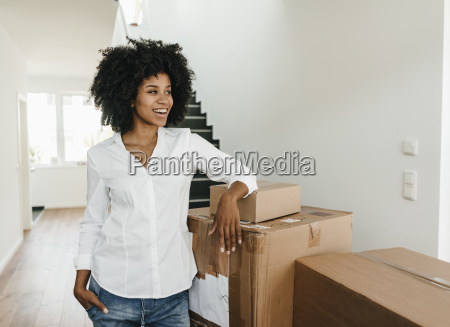 smiling young woman with cardboard boxes