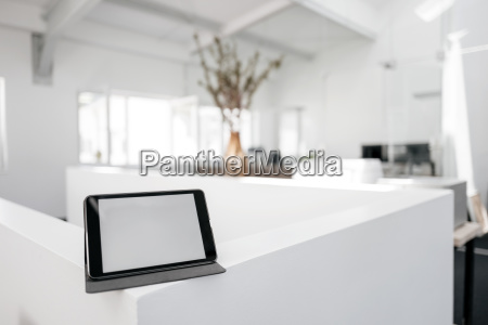 tablet on railing in office