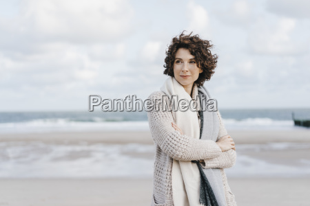 woman standing on the beach