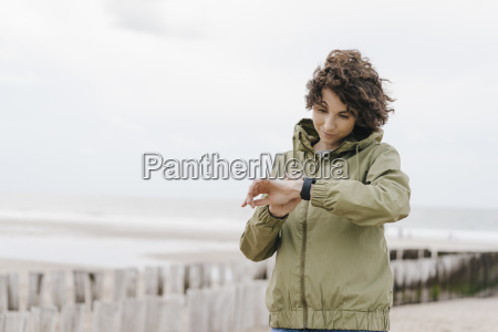 woman on the beach looking at