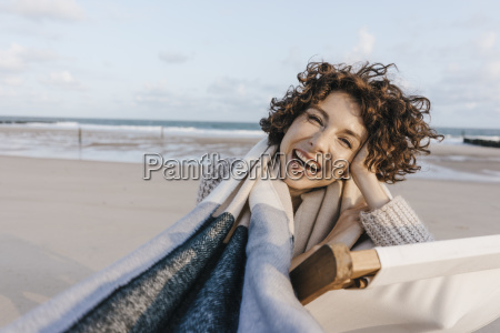 portrait of happy woman in deckchair