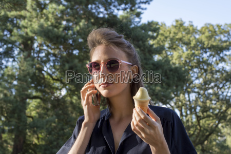 young woman with ice cone using