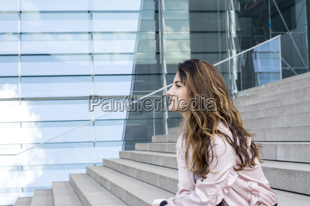 young woman sitting on stairs