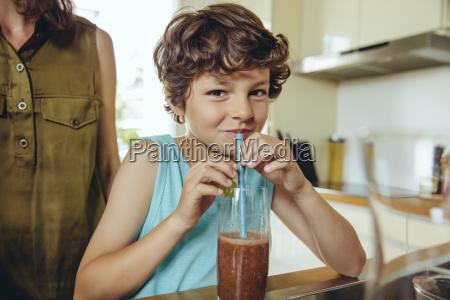 boy enjoying his homemade smoothie
