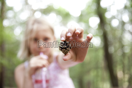 close up of girl holding pine