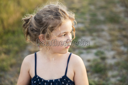 serious girl outdoors looking sideways