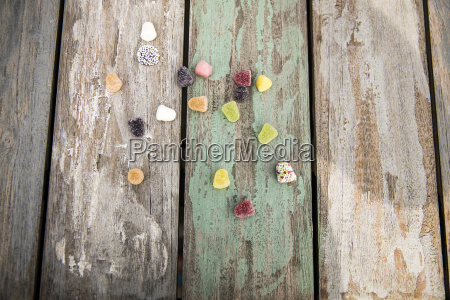 different sweets on wooden table