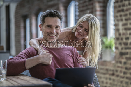 happy couple siting in country house