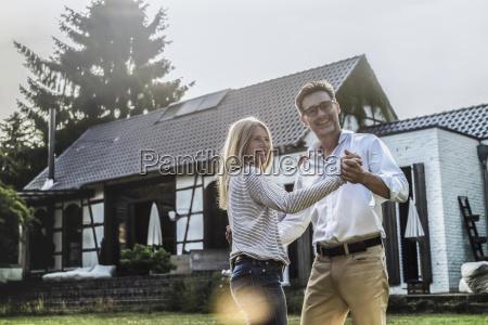 happy couple in the garden of