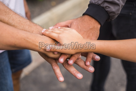 family stacking hands close up