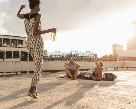 young woman dancing on a rooftop