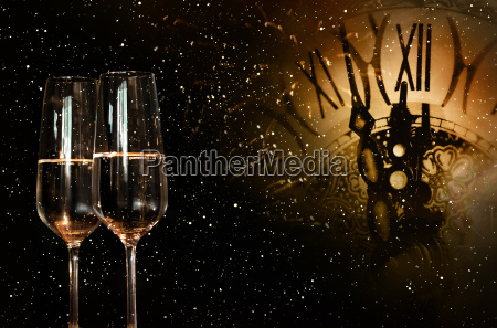 night sky with clock and champagne