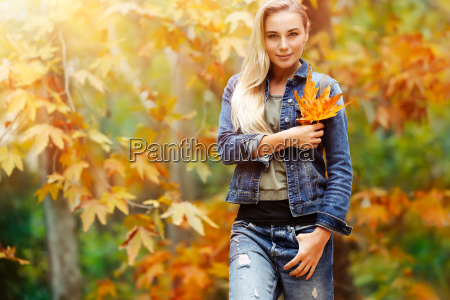 nice female in autumn park