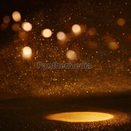 golden bokeh background with light spot