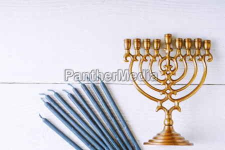 traditional hanukkah dishes on the white