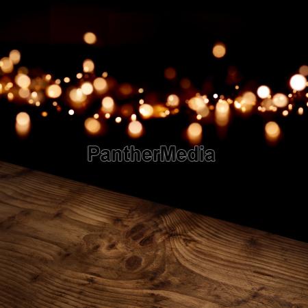 diagonal wooden table with festive bokeh