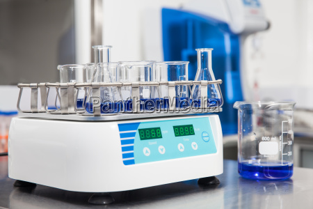 laboratory shaker loaded with erlenmeyers and