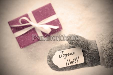 pink gift glove joyeux noel means