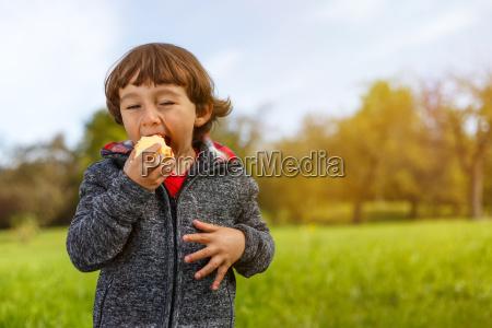 child apple fruit fruits eat outside