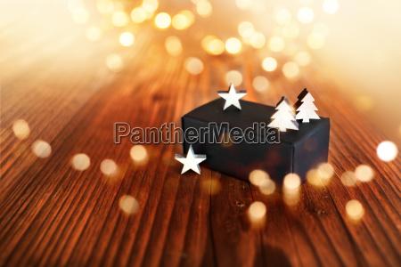 christmas gift with golden bokeh