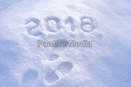 new year 2018 greeting footprints in