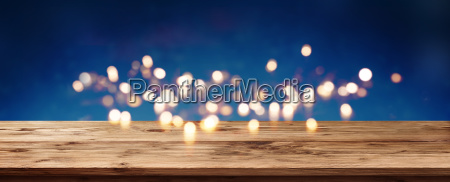 blue background with bokeh and wooden