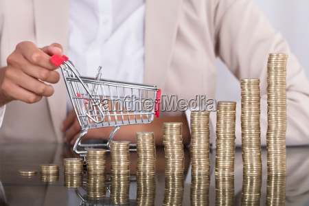businesswoman with stack of coins and