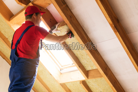 house attic insulation construction worker