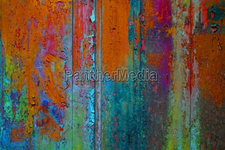 old wooden wall with many colorful