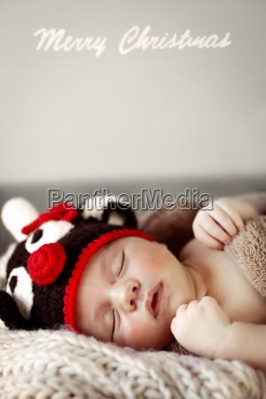cute baby sleeping in christmas costume