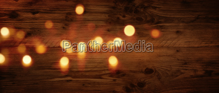 wood texture with festive golden bokeh