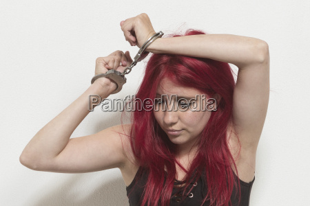 young redhead woman with handcuffs