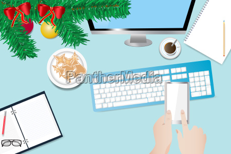christmas office desk with hand holding