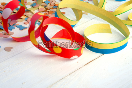 colorful streamers and confetti on white